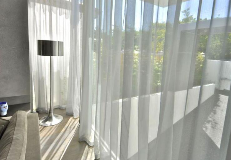 Peninsula Curtains and Blinds